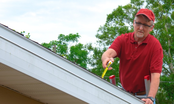 Roofer performing an annual maintenance check-up.